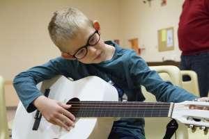 Guitariste de l'Harmonie Sainte Cécile